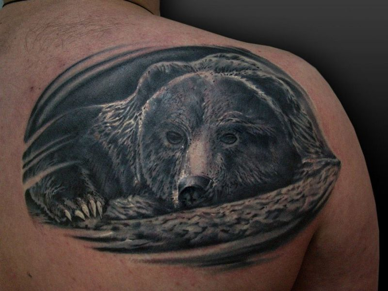 Black bear tattoo on shoulder back