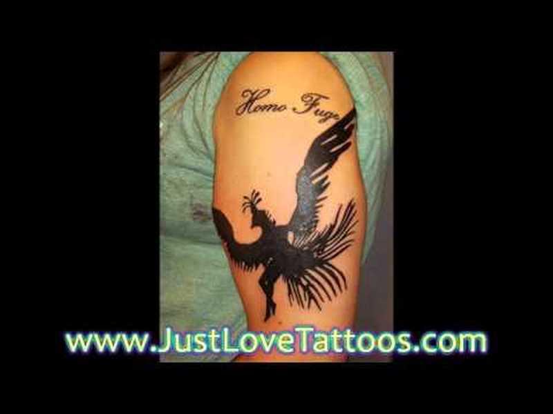 Black bird tattoo design on biceps