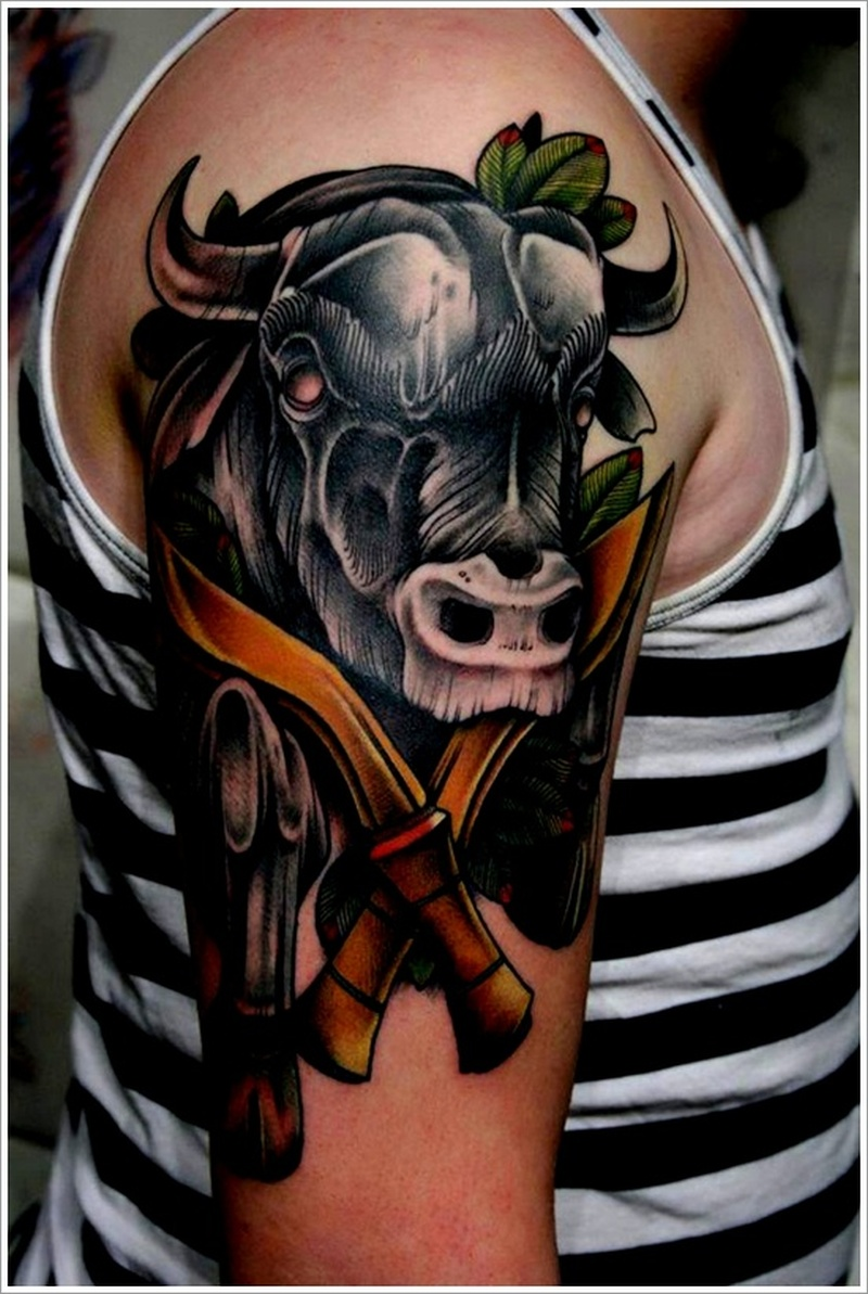 Black bull tattoo design with daggers on shoulder