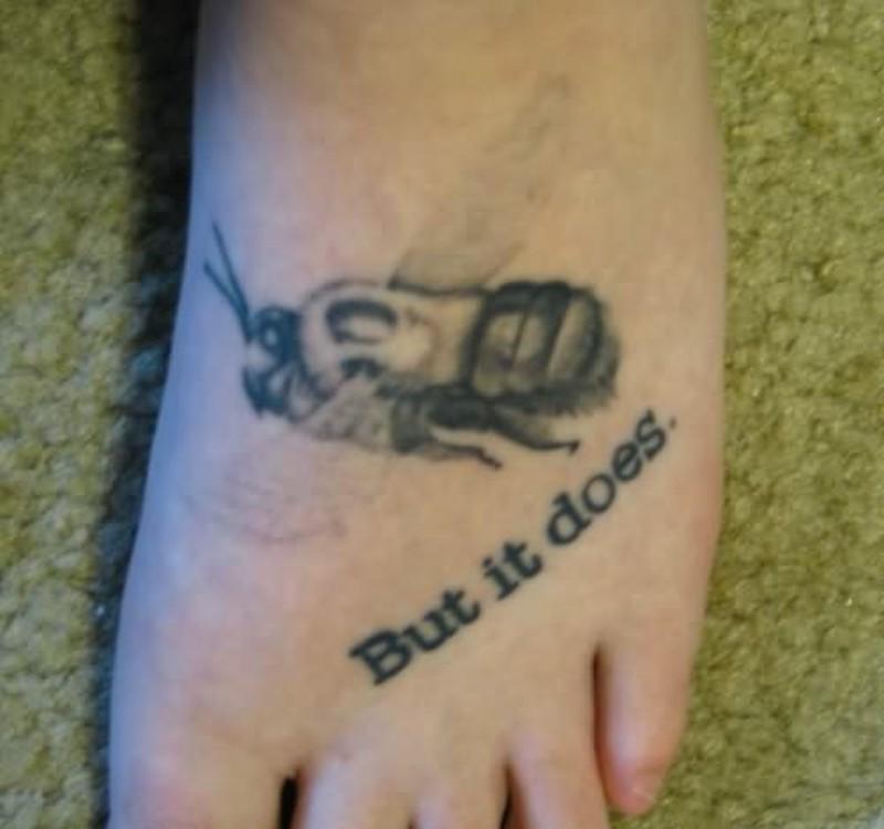 Black bumblebee tattoo on foot