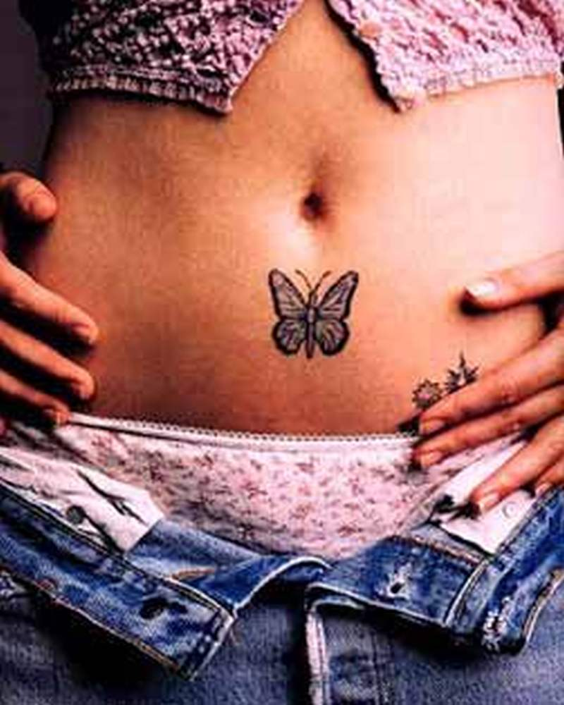 Black butterfly tattoo on belly