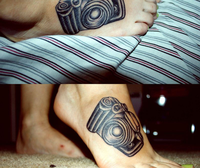 Black camera tattoo for foot