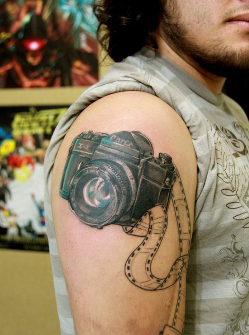 Black camera tattoo on shoulder for men
