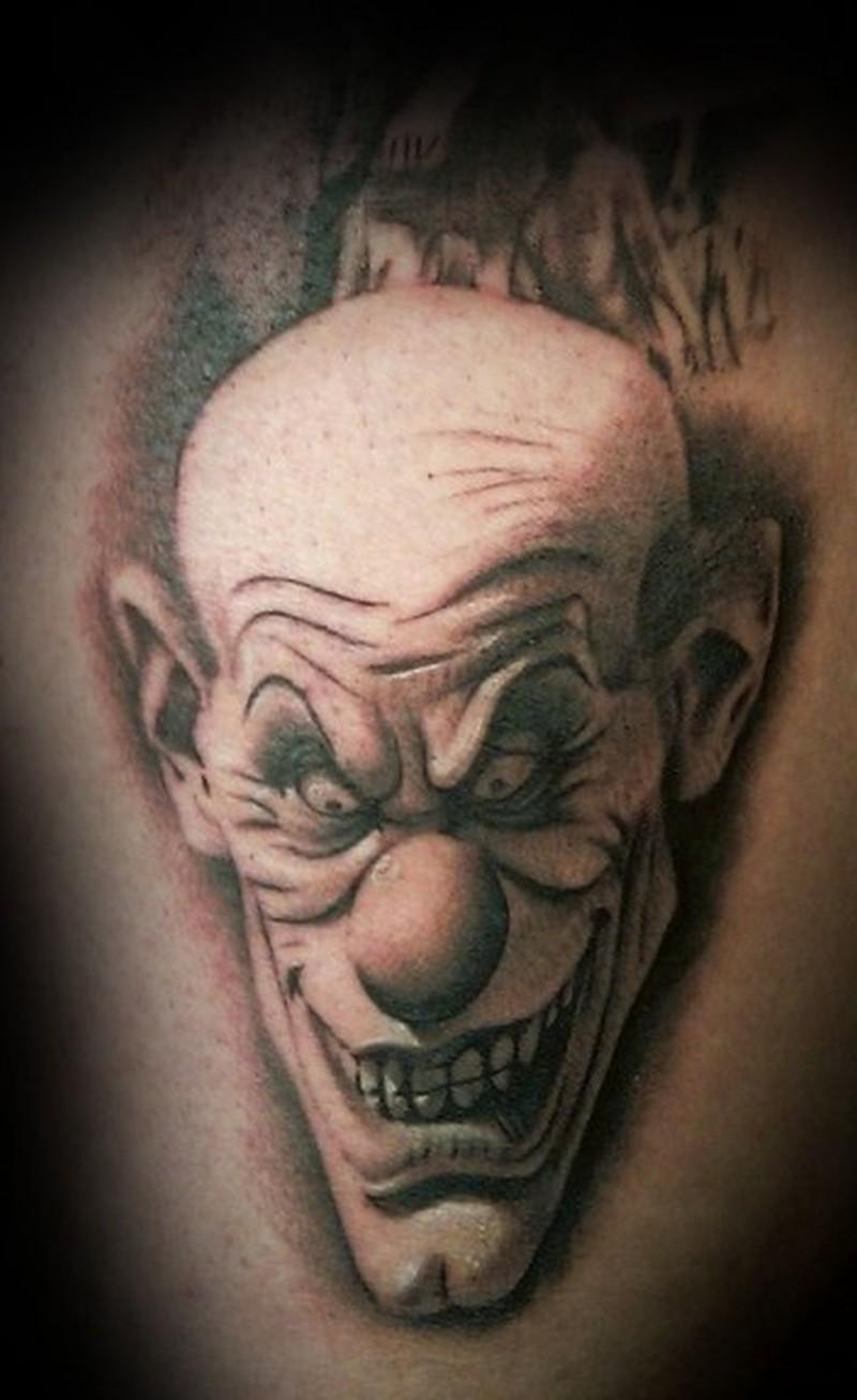 Black grey evil clown tattoo