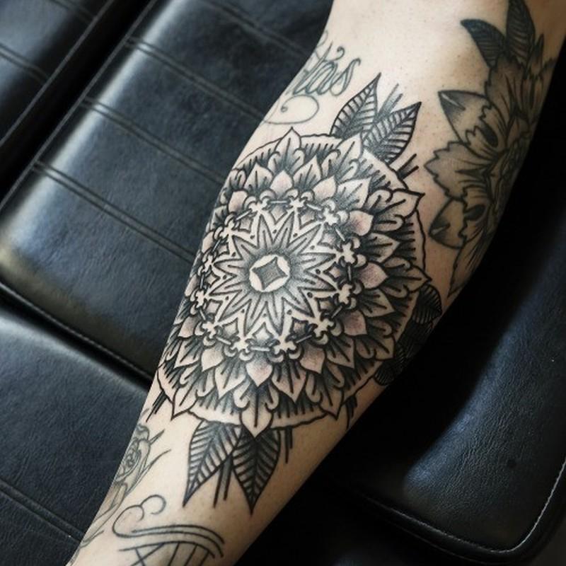 Black grey floral patterns forearm tattoo