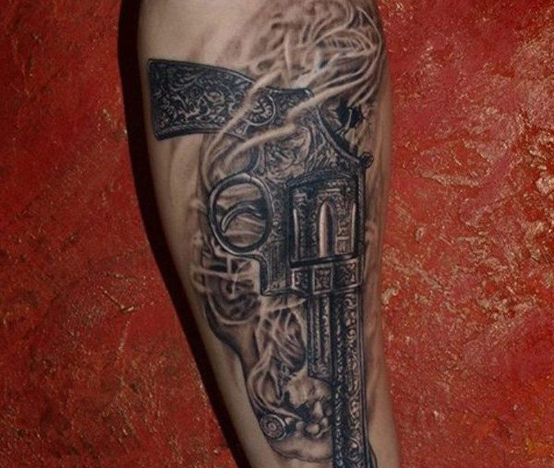 Black grey vintage gun forearm tattoo