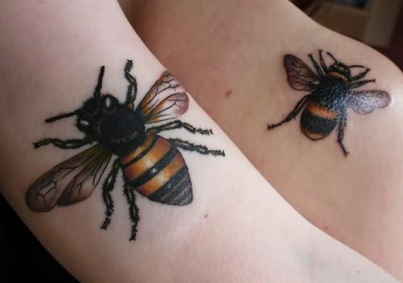 Black ink bumblebee tattoo designs