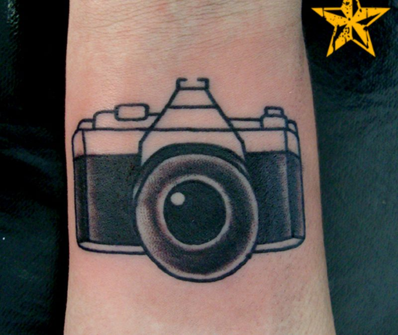 Black ink camera tattoo for wrist 2