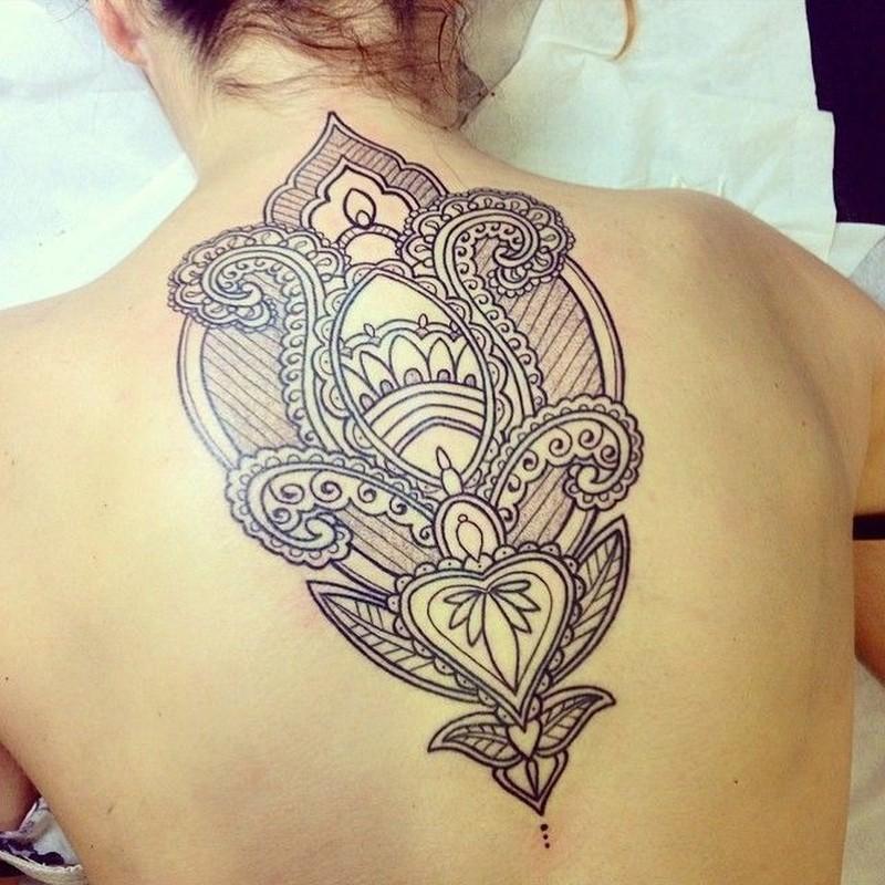Black lace pattern tattoo n upper back