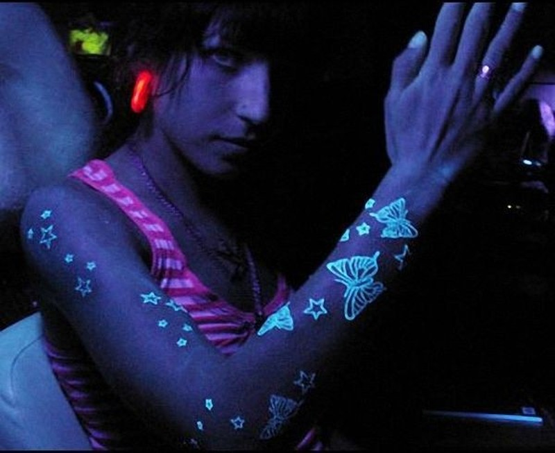 Black light stars and butterflies tattoo