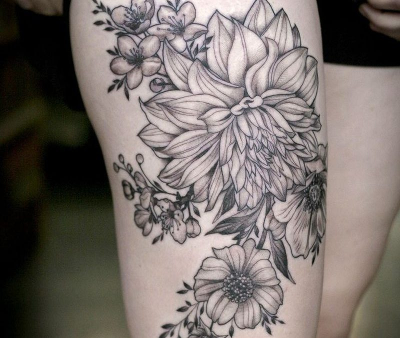 Black lines dahlias and garden flowers tattoo on hip by Alice Kendall