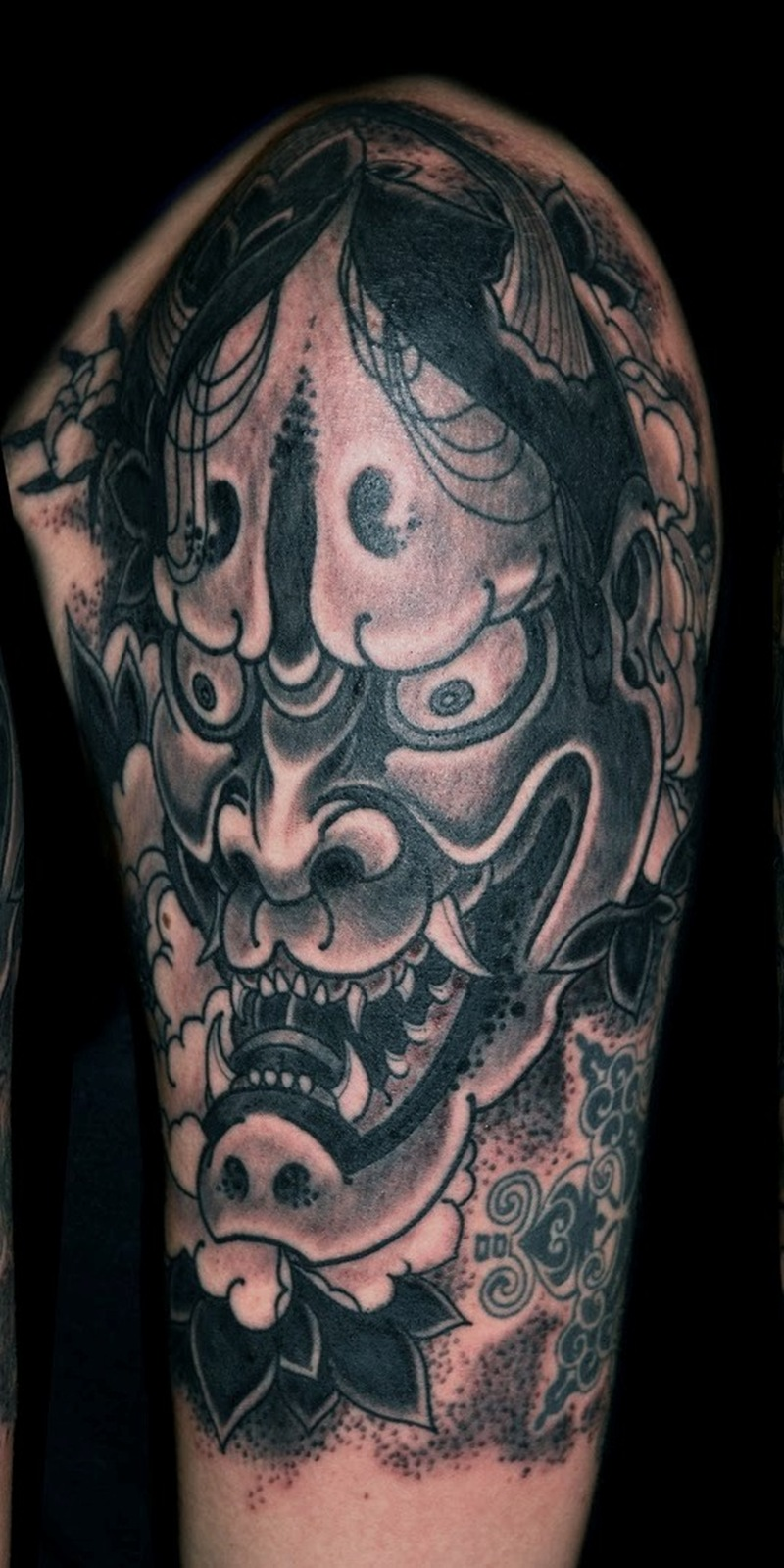 Black n grey demon half sleeve tattoo design