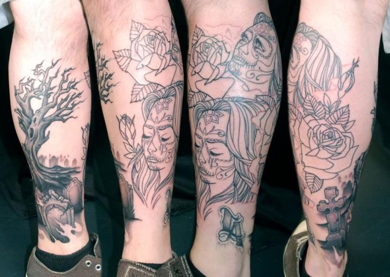 Black n grey ink graveyard tattoo on leg