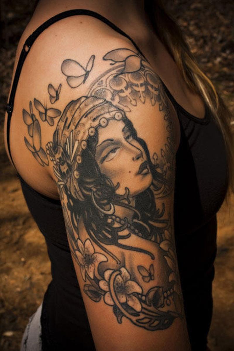 Black n grey ink gypsy tattoo on upper arm