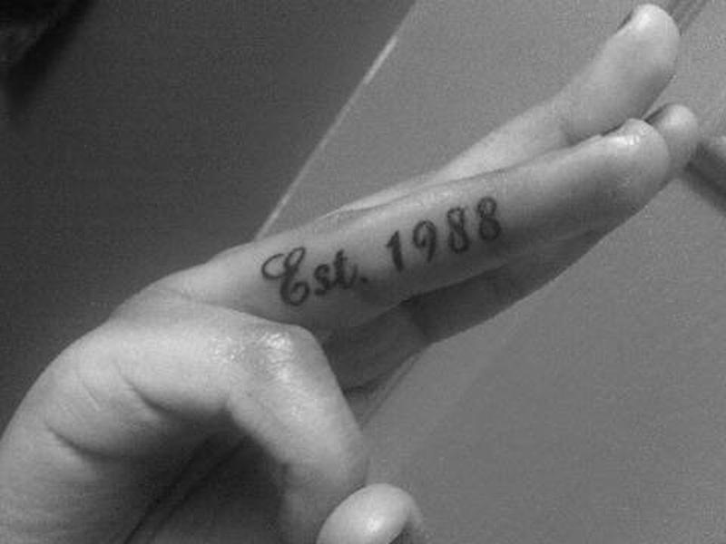 Black n white finger tattoo design