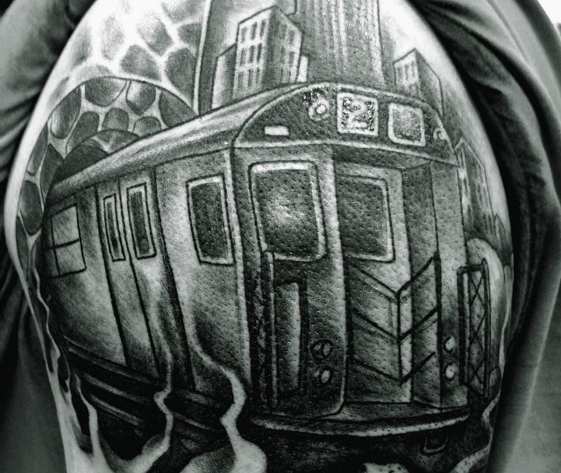 Black n white graffiti train tattoo on shoulder