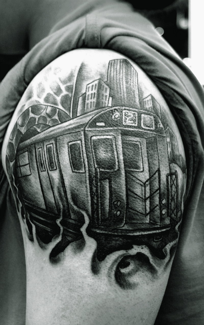Black n white graffiti train tattoo on shoulder