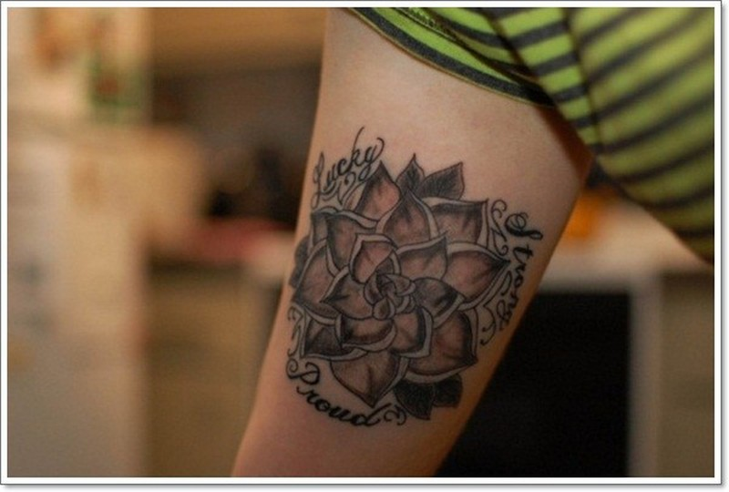 Black sacred lotus flower tattoo on arm