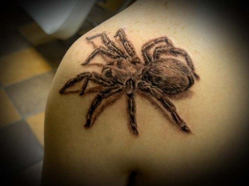 Black tarantula tattoo on shoulder