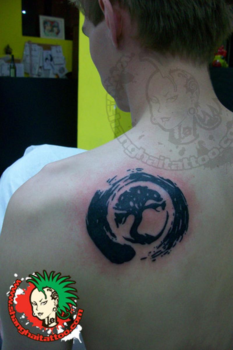 Black tree brush circle tattoo