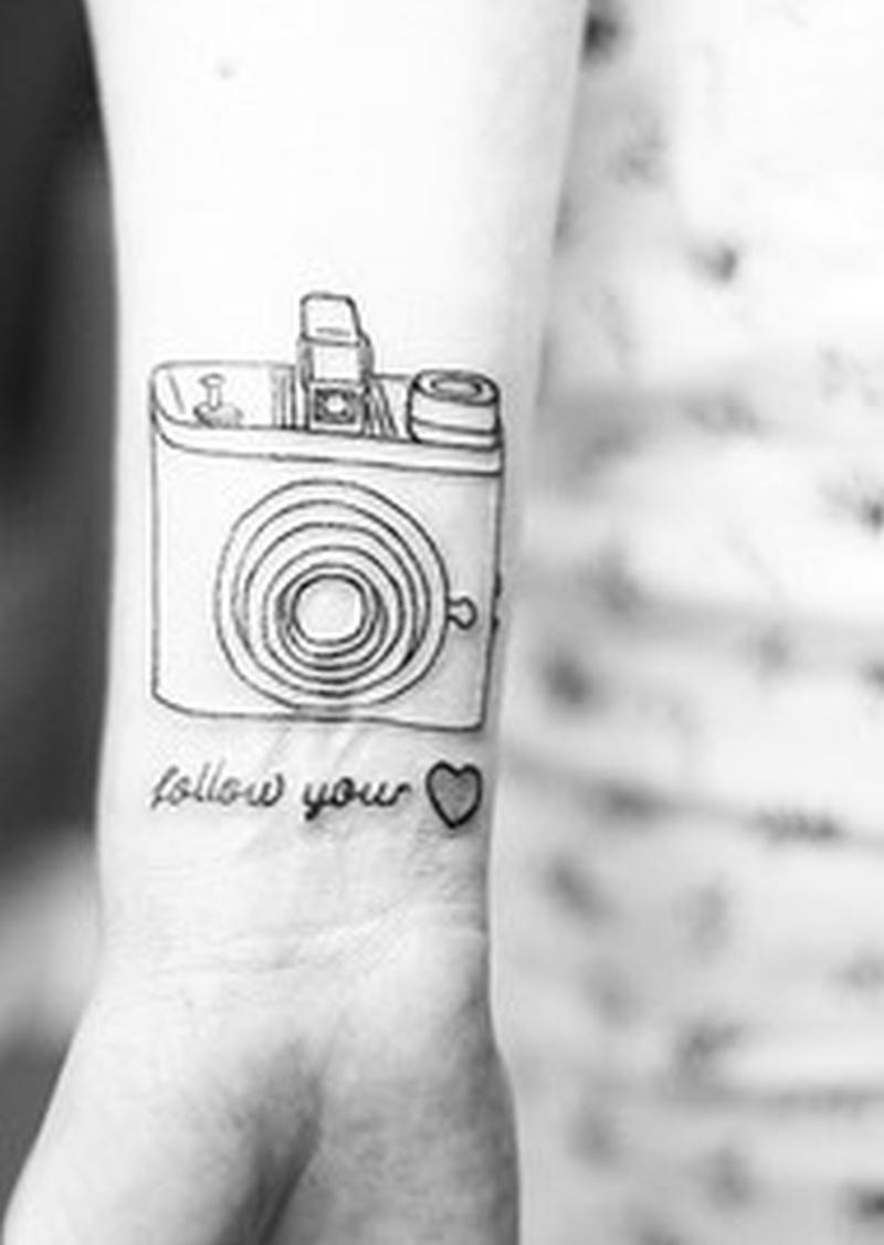 25ba4419a Black white camera tattoo on wrist - Tattoos Book - 65.000 Tattoos ...