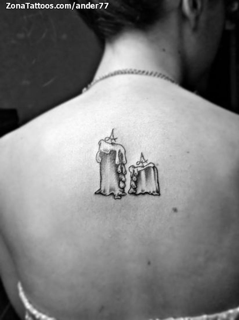 black white small candles tattoo on upper back tattoos book tattoos designs. Black Bedroom Furniture Sets. Home Design Ideas