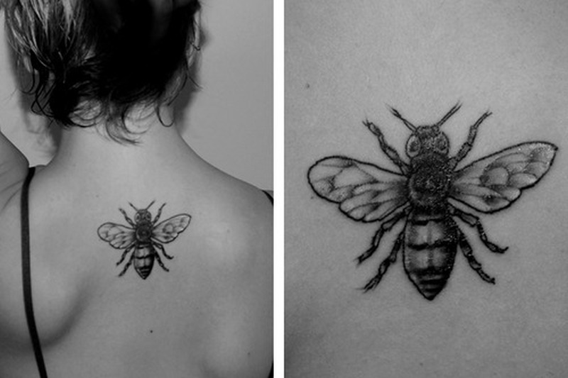 Black white upper back bee tattoo design