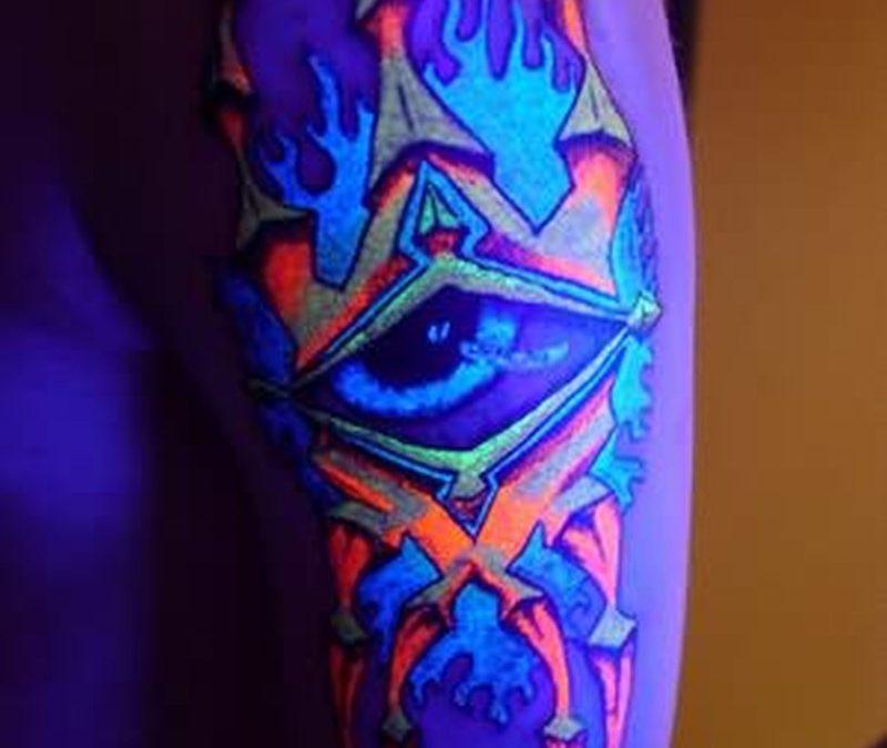 Blacklight eye tattoo