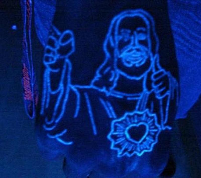Blacklight jesus tattoo