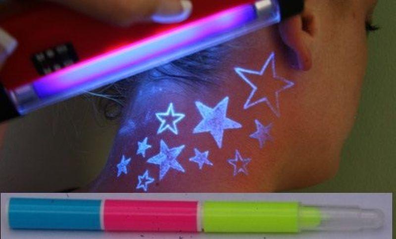 Blacklight stars tattoo on neck