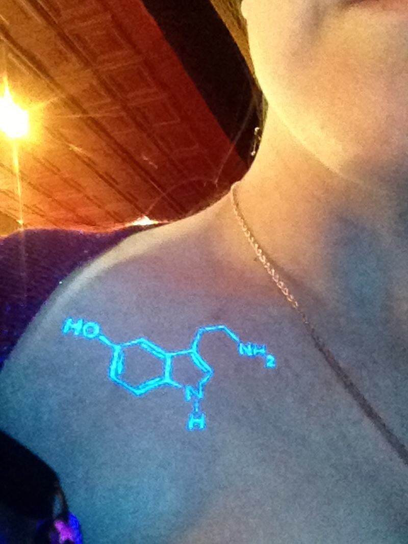 Blacklight tattoo on shoulder