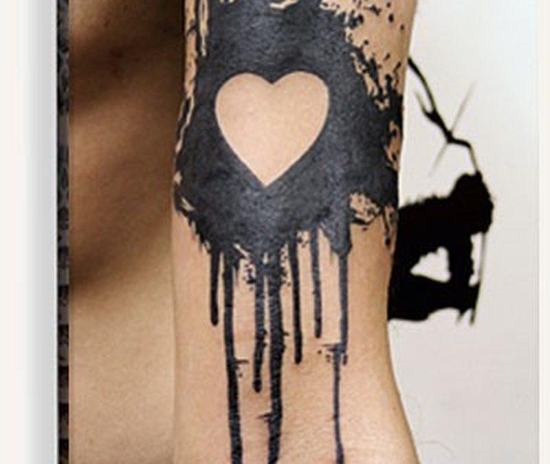 Bleeding black love heart tattoo design