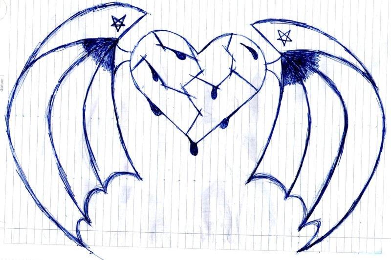 Bleeding broken heart with wings tattoo design