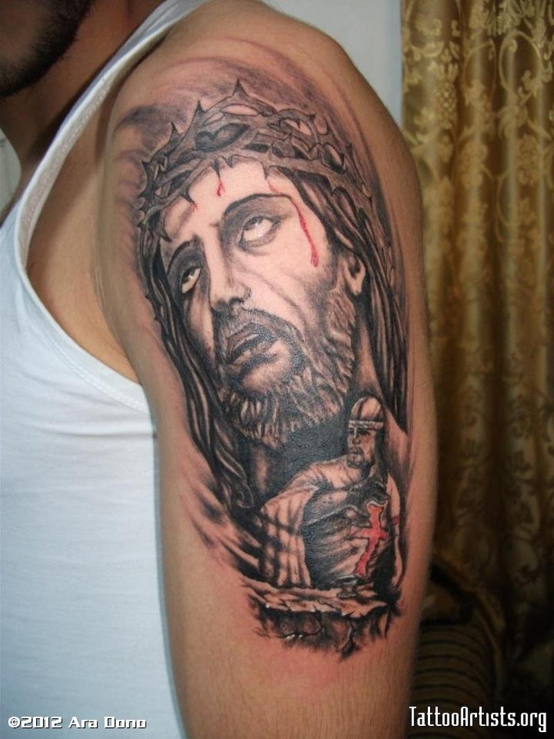 Bleeding jesus n warrior tattoo on biceps