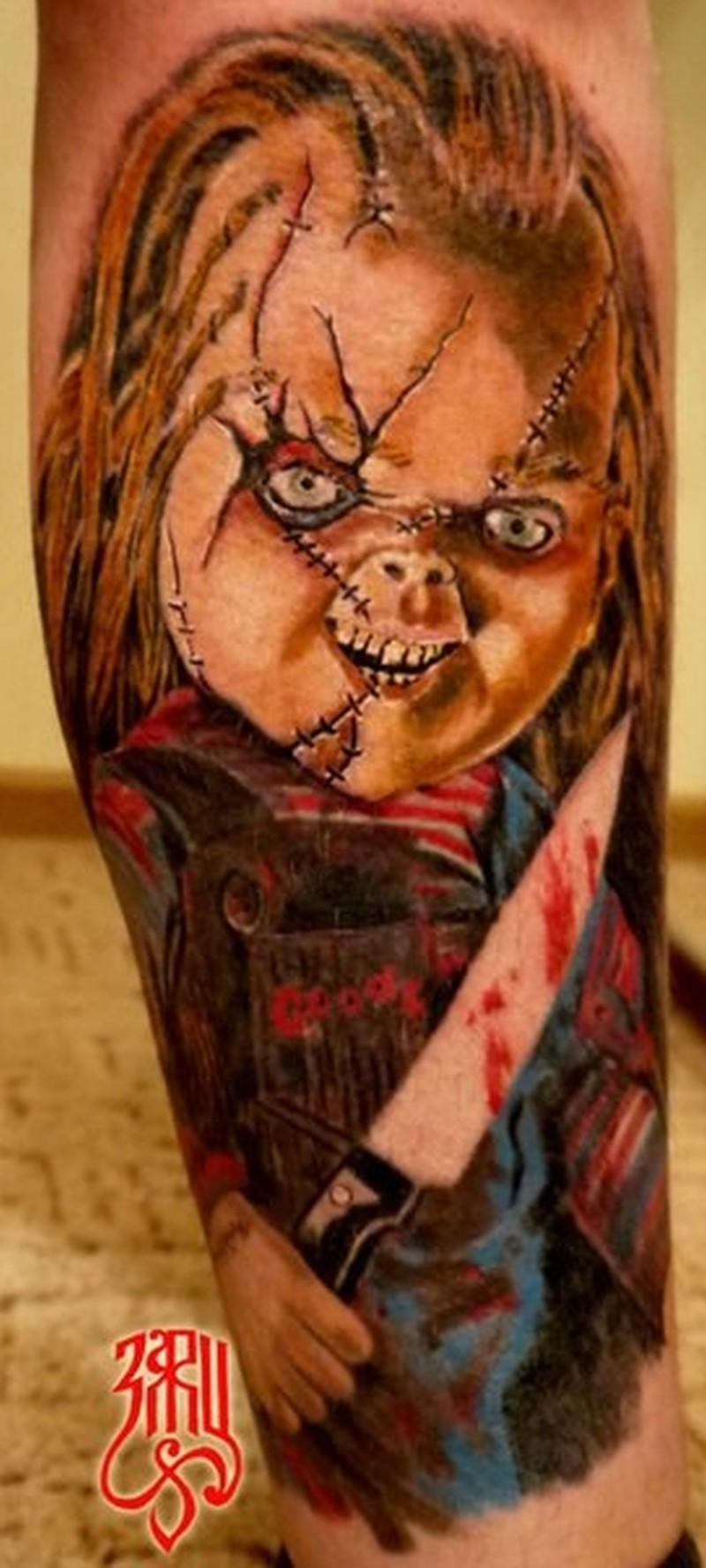 Bloodthirsty chucky movie horror tattoo on leg