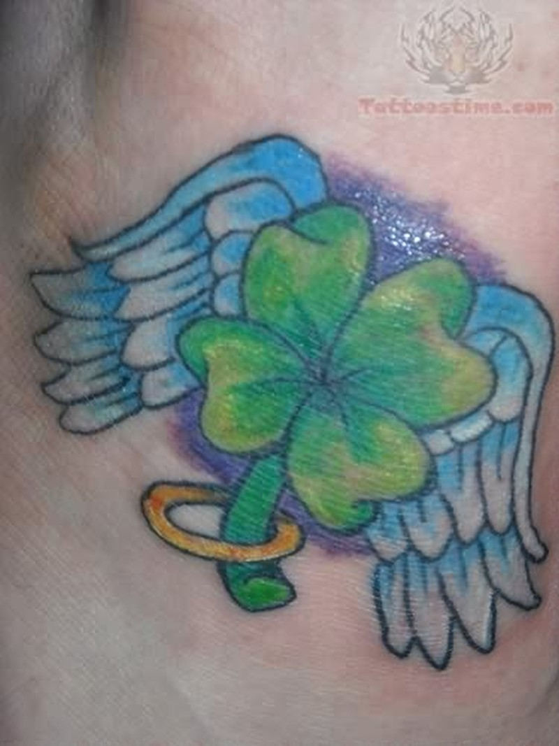 Blue angel wings with clover tattoo design