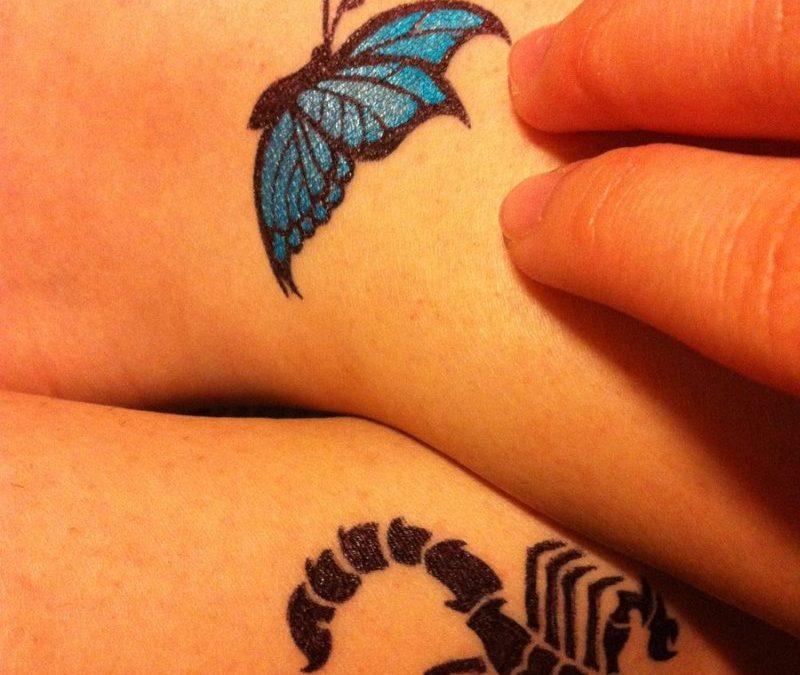 Blue butterfly scorpion tattoo