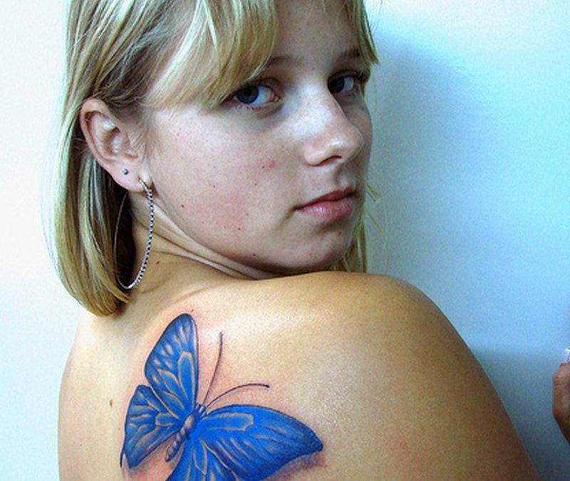 Blue butterfly tattoo on back shoulder 2