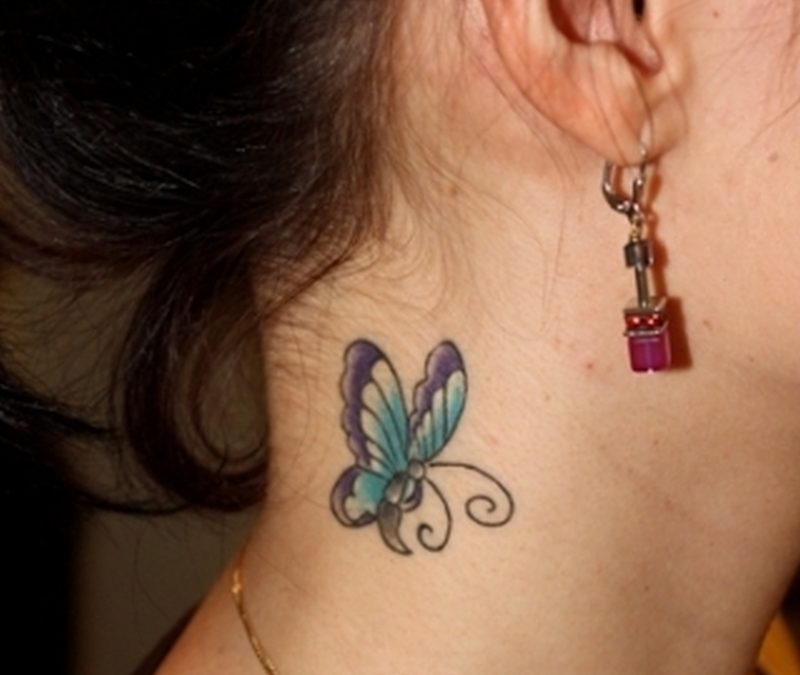 Blue butterfly tattoo on neck