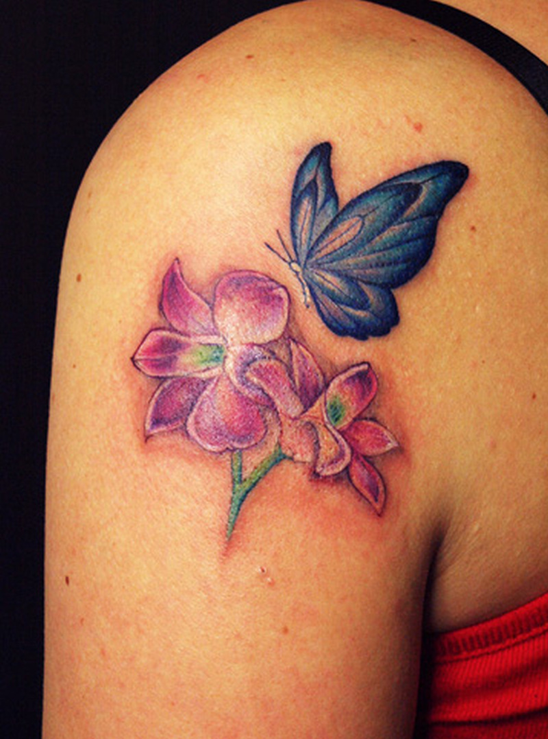 Blue butterfly with flowers tattoo on shoulder