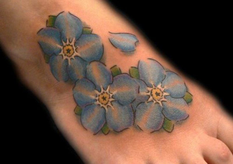 Blue Flower Tattoo Design Blue daisy flowers tat...