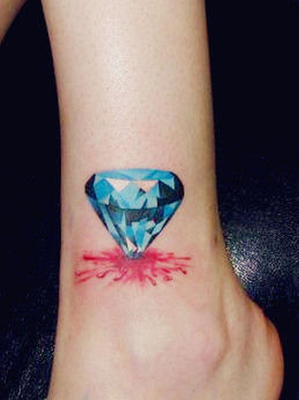 Blue diamond tattoo on ankle