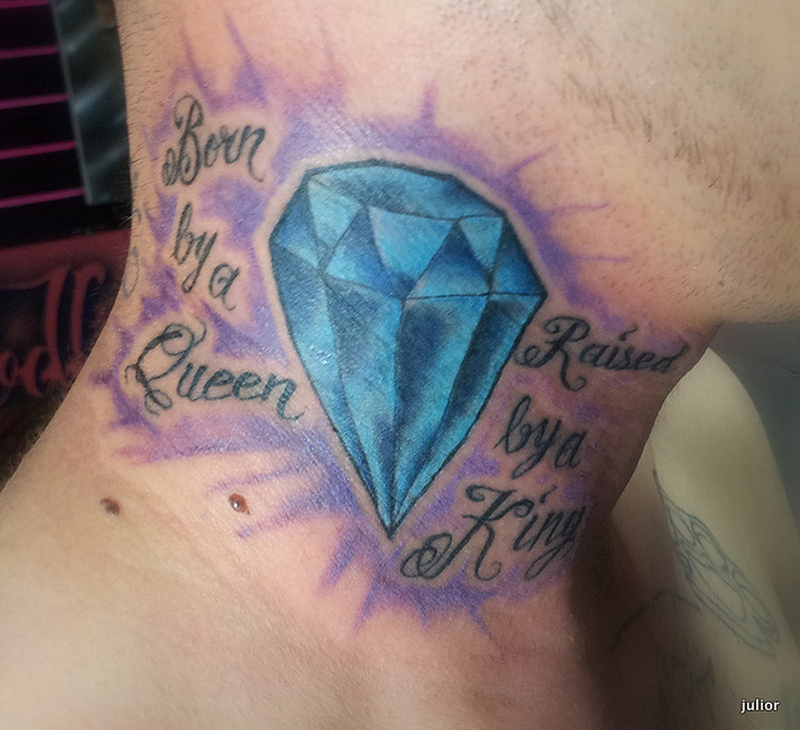 Blue diamond tattoo on neck