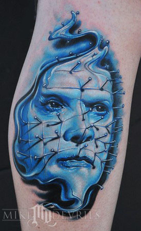 Blue ink pin head tattoo design