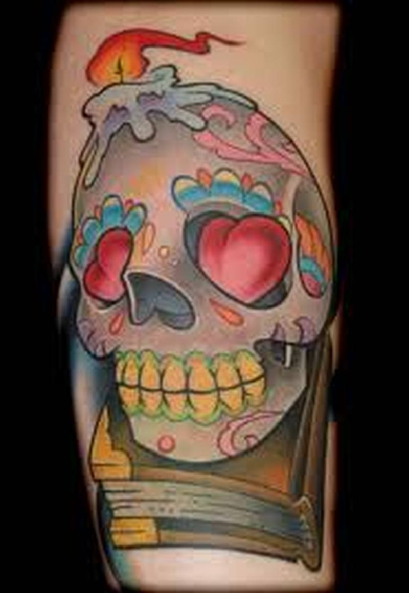 Book skull with candle tattoo design