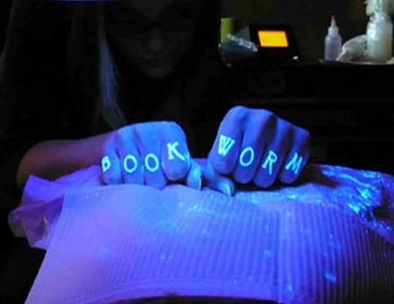 Book worm blacklight tattoo on fingers