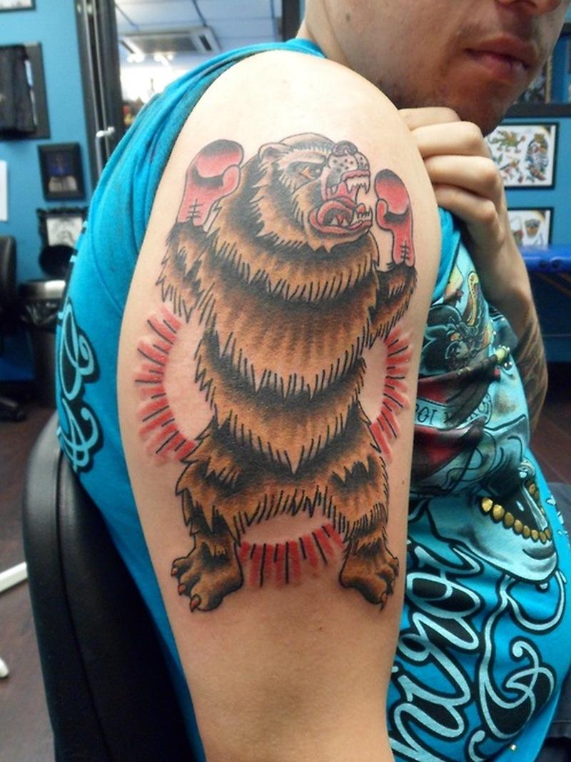 Boxer bear tattoo on biceps