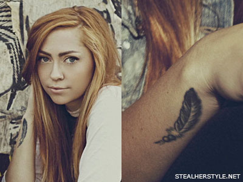 Brandi cyrus cross feather tattoo