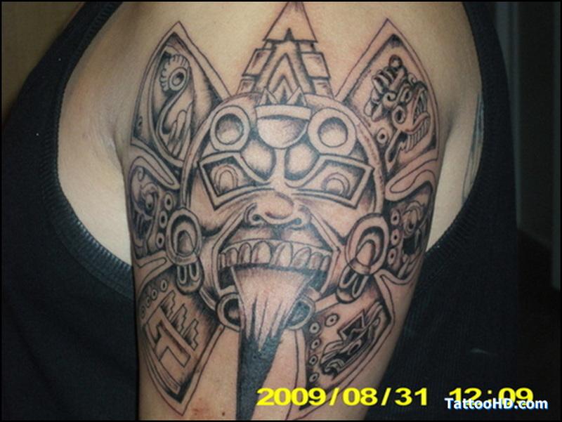 Brilliant aztec tattoo on biceps