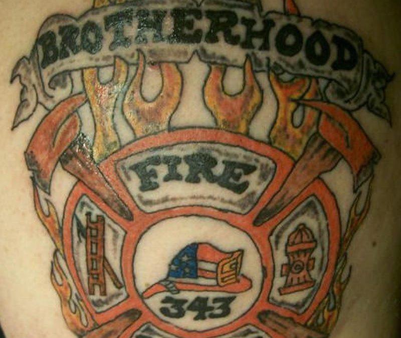 Brotherhood firefighter tattoo on skin